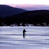 A silhouette of a fisherman drilling a hole on Pontoosuc Lake in Pittsfield on Monday evening in Pittsfield. (January 6th 2014 Holly Pelczynski/Berkshire Eagle Staff)