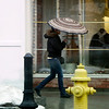 A pedestrian walks on North st. with umbrella in hand on Monday afternoon, while temperatures and weather changes dramatically with rain and snow coming to the Berkshires. (January 6th 2014 Holly Pelczynski/Berkshire Eagle Staff)