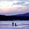 A silliohette of two fishermen on Pontoosuc Lake in Pittsfield on Monday evening in Pittsfield. (January 6th 2014 Holly Pelczynski/Berkshire Eagle Staff)