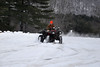 Mike Bloom, from Williamstown, rides his four wheeler in the fresh snow left after Friday's snow storm at Windsor Lake.(Jack Guerino/North Adams Transcript)