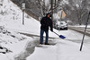 Mark Mancini, a MCLA worker from North Adams, cleans up the side walk near the Berkshire Towers Friday. MCLA workers worked tirelessly to clean up the snow left by the Friday's snow storm so students could be more easily picked up for winter break.(Jack Guerino/North Adams Transcript)