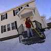 KRISTOPHER RADDER — BRATTLEBORO REFORMER<br /> Colleen Murphy uses a brook to clear the snow off her steps on Oak Grove Avenue on Wednesday, Jan. 30, 2019.