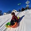 KRISTOPHER RADDER — BRATTLEBORO REFORMER<br /> Otis Davis, 3, slides down the hill at the Brattleboro Little League Field as his father Josh watches on Wednesday, Jan. 30, 2019.