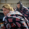 John Cross<br /> Blankets and hot coffee were the order of the day for Minnesota Twins fans Danne Boley and Chris Buck as they boarded a bus to take them to the season opener Monday at Target Field.