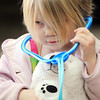 John Cross<br /> Four-year-old Emily Busse has a cooperative patient in her teddy bear as she examines him during a Teddy Bear Clinic Thursday during a Children's Story Hour at the Blue Earth County Library.