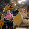 John Cross<br /> United South Central High School student Samantha Andrews operates a backhoe during a high school career fair Wednesday at the Verizon Wireless Center.