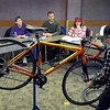 Key City Bike's Pat Kelly demonstrates how to do a safety check on a bicycle during the Sustainability Expo Saturday at Minnesota State University.  Photo by Pat Christman