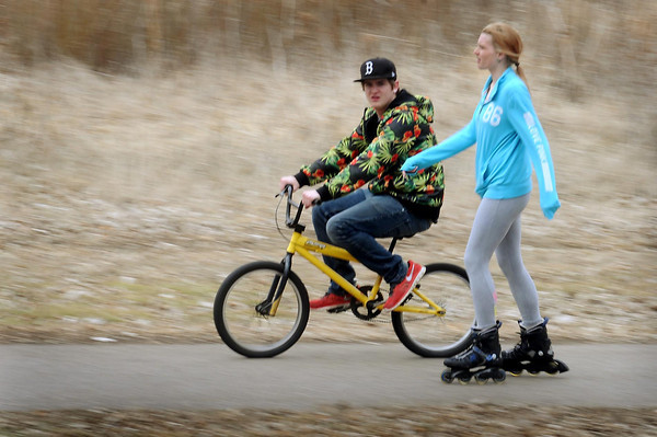 Adam Schwieger and Andrea Finneman took a break from their college studies to sample the fleeting spring weather on Monday by cruising along the trail along the Minnesota River. Photo by John Cross