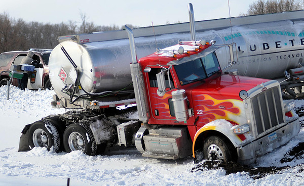 A casualty of Friday's snow, a jack-knifed semi-tanker partially blocked Highway 68 at the junction with Highway 169-60 south of Mankato. Photo by John Cross