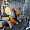 A victim is extricated from a rail car as part of a confined space rescue training session Thursday at Horizon Milling.<br /> Mankato Department of Public safety personnel along with firefighters from Winona and Faribault participated in the exercise. Photo by John Cross