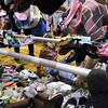 Matt Beckendorf helps his daughter Luella, 6, try on shoes at the Munchkin Market Saturday at the Verizon Wireless Center.  Photo by Pat Christman