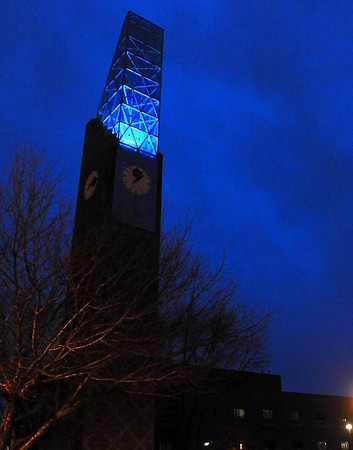 MSU's bell tower is typically lit in various colors, including purple. Photo by Pat Christman