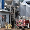 Firefighters head toward a dryer charred by a fire Tuesday afternoon at the elevator in Blakeley. No one was injured and the fire was extinguished before it reached the elevator itself. Pat Christman