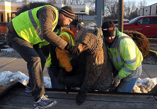 "Workers load ""Sitting Bear"" on to a trailer as they remove the sculptures on the CityArt Walking Sculpture Tour Saturday. Photo by Pat Christman"