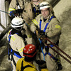 Firefighters tend lines used during a confined space rescue training session held at Horizon Milling on Thursday. Photo by John Cross