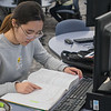 Sohee Kim, a junior chemistry major, reads through her organic chemistry textbook at the Minnesota State library on Friday. Kim said she paid roughly $800 for four textbooks this semester. Photo by Jackson Forderer