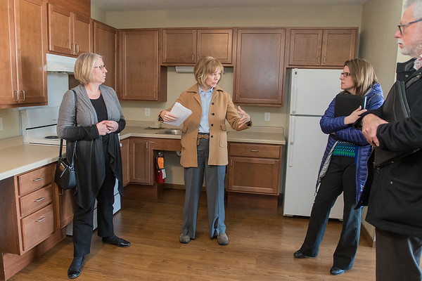 U.S. Senator Tina Smith (center) talks with from left, Joleen Pfau, Stephanie Vergin and Rick Goodemann at Maplewood Apartments, an affordable housing complex in St. Peter with 30 units. Smith was in St. Peter to discuss affordable housing with local officials planning the Solace Apartments. Photo by Jackson Forderer