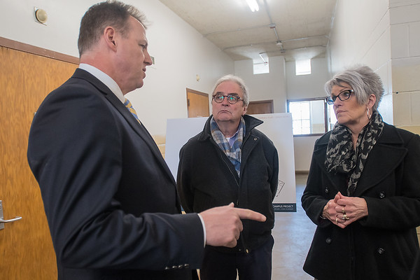 Senator Nick Frentz (left), DFL-North Mankato, talks with Representative Clark Johnson (center), DFL-North Mankato, and Nancy Johnston, the executive director of the Minnesota sex offender program in a building that is being recommended for renovation by the Department of Human Services at the St. Peter Regional Treatment Center on Friday. Photo by Jackson Forderer