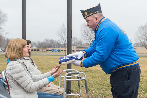Susan Dorsey gives an American flag to Jeff Frye of the North Mankato American Legion Post 518 to be flown in honor of her uncle Cpl. Elmer Dahn at the Veteran of the Month ceremony held at Wheeler Park on Saturday. Efforts have begun to recover Dahn's remains from Korea. Photo by Jackson Forderer