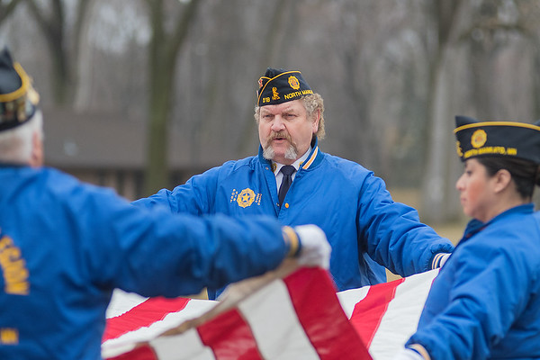 Pete Hagert with the North Mankato American Legion Post 518 folds the American flag with fellow Legion members at the Veteran of the Month ceremony held at Wheeler Park on Saturday. Photo by Jackson Forderer