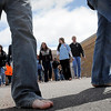 "John Cross<br /> South Central College students step out sans shoes Tuesday as part of a ""One Day Without Shoes."" Participants in the event designed to show the impact a pair of shoes can make in a person's life received discounts at the SCC bookstore for donating a pair of shoes."