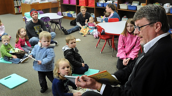 John Cross<br /> Blue Earth County Board Chairman Drew Campbell reads to youngsters during a Blue County Library Story Hour on Thursday.