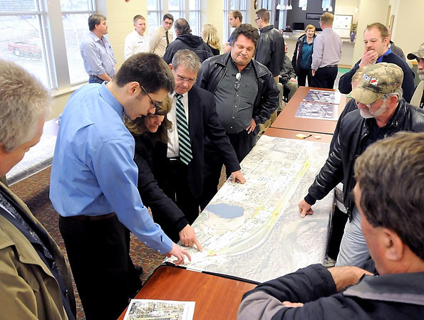 Minnesota Department of Transportation's Zak Tess (left, in blue shirt) explains part of a map showing proposed changes to the access of State Highway 169 north of St. Peter during a meeting Wednesday at the St. Peter Community Center.