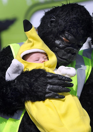 Mindy Williams holds her 2-month-old son Elijah before the start of the Gorilla Fun Run Saturday at Minnesota State University.