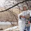 John Cross<br /> It certainly didn't feel or look like a spring fishing trip for brothers Faico (left) and Neng Xiong, both of Minneapolis, as they angled for trout at Paul's Creek near St. Peter on Thursday.