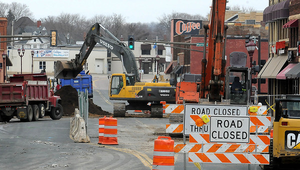 Construction equipment works on the 500 block of South Front Street on Thursday.