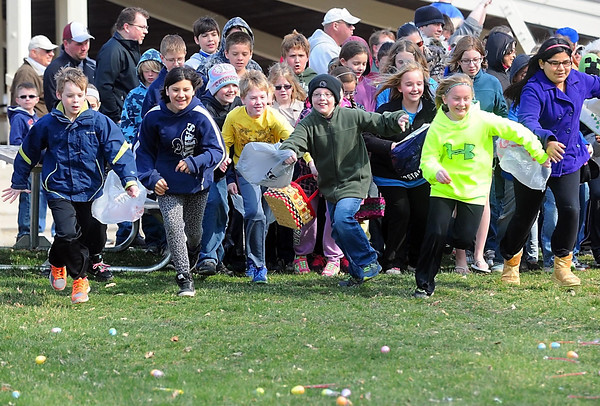 Children race after Easter eggs at the St. Peter Jaycees Easter egg hunt Saturday at Minnesota Square Park. Photo by Pat Christman