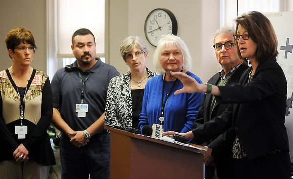 Minnesota Human Services Commissioner Lucinda Jesson talks about Minnesota Security Hospital bonding, flanked by  hospital staff (from left), Nancy Johnston, MSOP executive director, Tim Headlee, lead security counselor,<br /> Carol Olson, hospital CEO,  Rita Olson, MSH program director and Rep. Clark Johson. Photo by John Cross