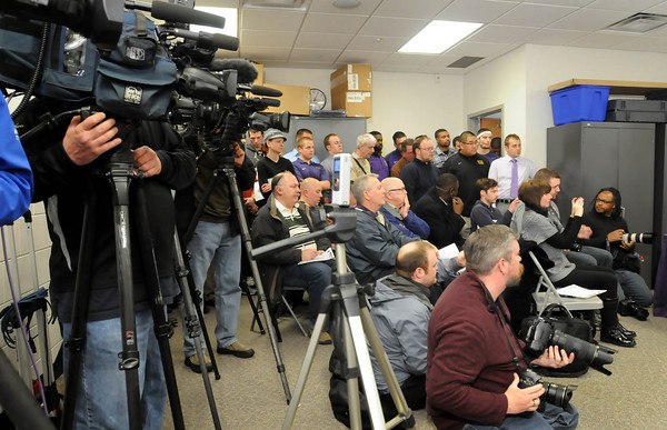 Media crowd into a small room at MSU's Pennington Hall  for a press conference regarding the return of Todd Hoffner as head coach of the football team. Photo by John Cross