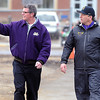 Minnesota State University athletic director Kevin Buisman walks with football head coach Todd Hoffner before Hoffner's first practice after being reinstated as the team's head coach Wednesday.  Photo by Pat Christman