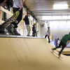 A skate boarder drops in to the indoor half pipe at the newly opened temporary YMCA skate park in the former Madison Avenue fire hall Saturday. at Photo by Pat Christman