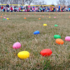 Children anxiously wait to pick up Easter eggs during the annual Mankato Jaycees Easter egg hunt Saturday at Jaycee Park. Photo by Pat Christman