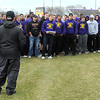 Reinstated Minnesota State head football coach Todd Hoffner listens to a statement read by football player Samuel Johnson as the rest of the team stands by Wednesday. The team decided to not practice Wednesday.  Photo by Pat Christman