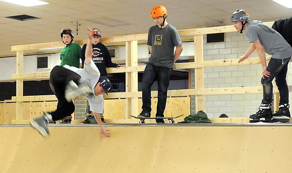 An inline skater does a trick on one of the ramps at the temporary indoor skate park Saturday. Photo by Pat Christman
