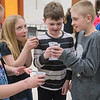 Caden Friedrichs (right) and Wyatt Roelofs (second from right) pretend to cheers their cups of dirt along with classmates Maya Gilman (left) and Alicen Hanson at Environmental Learning Day. The four fourth-graders at Lake Crystal Elementary School received cups of dirt to grow plants from Kirsten Phelps' presentation about growing fruits and vegetables. Photo by Jackson Forderer