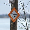 A Thin Ice sign at the public access point for Madison Lake. Photo by Jackson Forderer