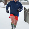 Jeff Schultz runs along Belgrade Avenue in North Mankato on Saturday afternoon. Schultz also stopped to help out a stuck car along his route. Photo by Jackson Forderer