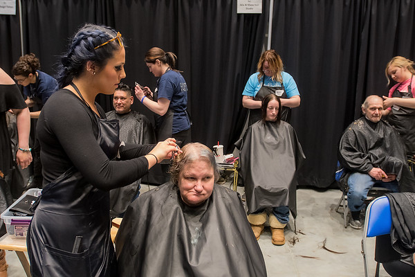 Rachel Denhof (left) gives Debby Tennant a haircut at Project Community Connect held on Tuesday at the Verizon Performance Center. Over 25 stylists were on hand to give free haircuts at the community event put on by numerous nonprofit agencies. Photo by Jackson Forderer