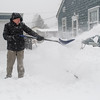 Tony Francour shovels snow off of his driveway on Sherman Street in North Mankato on Saturday. Francour said it's easier to shovel snow in smaller amounts than to wait to shovel once when the snow has finished falling. Photo by Jackson Forderer