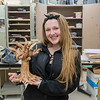 Lindsey Lawton, 16, with her clay sculpture titled Growth, at Mankato East. Photo by Jackson Forderer
