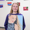 Brandi Drumm, 17, with her acrylic self-portrait painting at Mankato East. Photo by Jackson Forderer