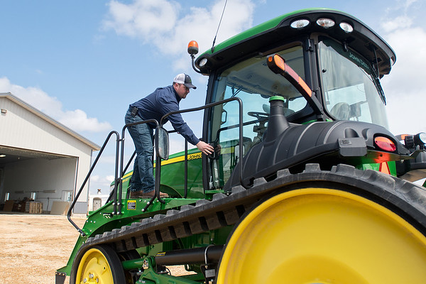 Bob Roelof opens the door to his cab on his tractor at his farm in rural Garden City. Roelof said that on average, it takes him three weeks to plant his fields. Photo by Jackson Forderer