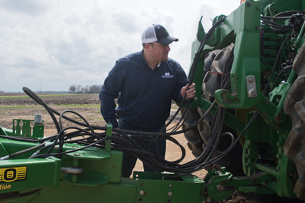 Bob Roelof checks his hydraulic hoses at the back of tractor on his farm in rural Garden City. Photo by Jackson Forderer