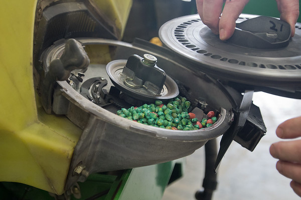 Bob Roelof shows the seeds inside of a planter at his farm in rural Garden City. Roelof said that farmers will be getting nervous if they can't start planting sometime next week. Photo by Jackson Forderer