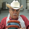 Rogaciano Hernandez carries a small stack of tortilla holders in the dish room at La Plaza Fiesta restaurant in Madelia on Saturday in Madelia. Saturday was the last day the restaurant was open at its temporary location. They plan to open their downtown location in June. Photo by Jackson Forderer