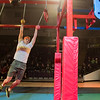 Jacob Prokosch swings along the obstacle course in the Mankato Ninja Warrior competition held on Thursday at Bresnan Arena. Matthew Drosky, a Minnesota State student, took first place in the competition. Photo by Jackson Forderer
